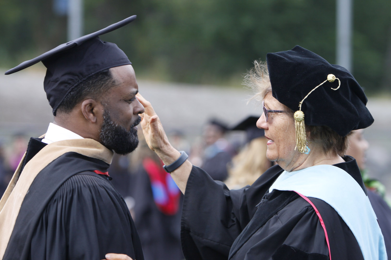 Student receiving degree at Commencement