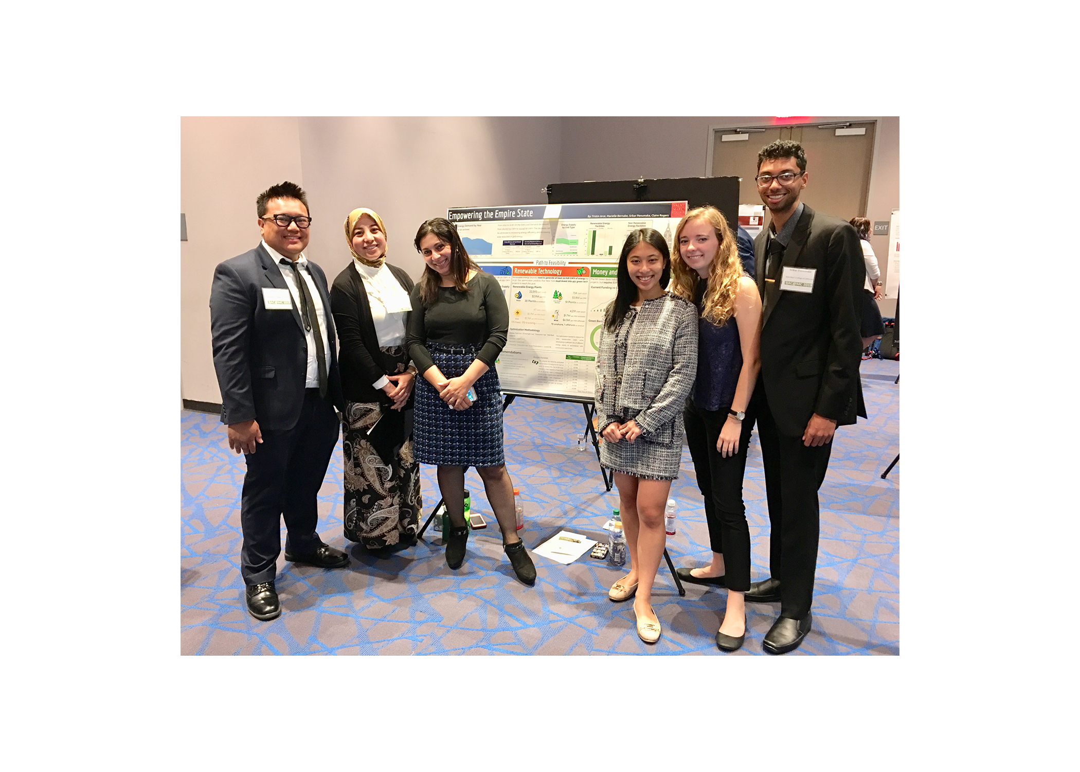 1st Place Business Analytics Poster Team members: SMC's Business Analytics students Tristin Arce '19, Marielle Bernabe '19, Srikar Penumaka '20, and Claire Rogers '19 won first place with their poster, Empowering the Empire State.