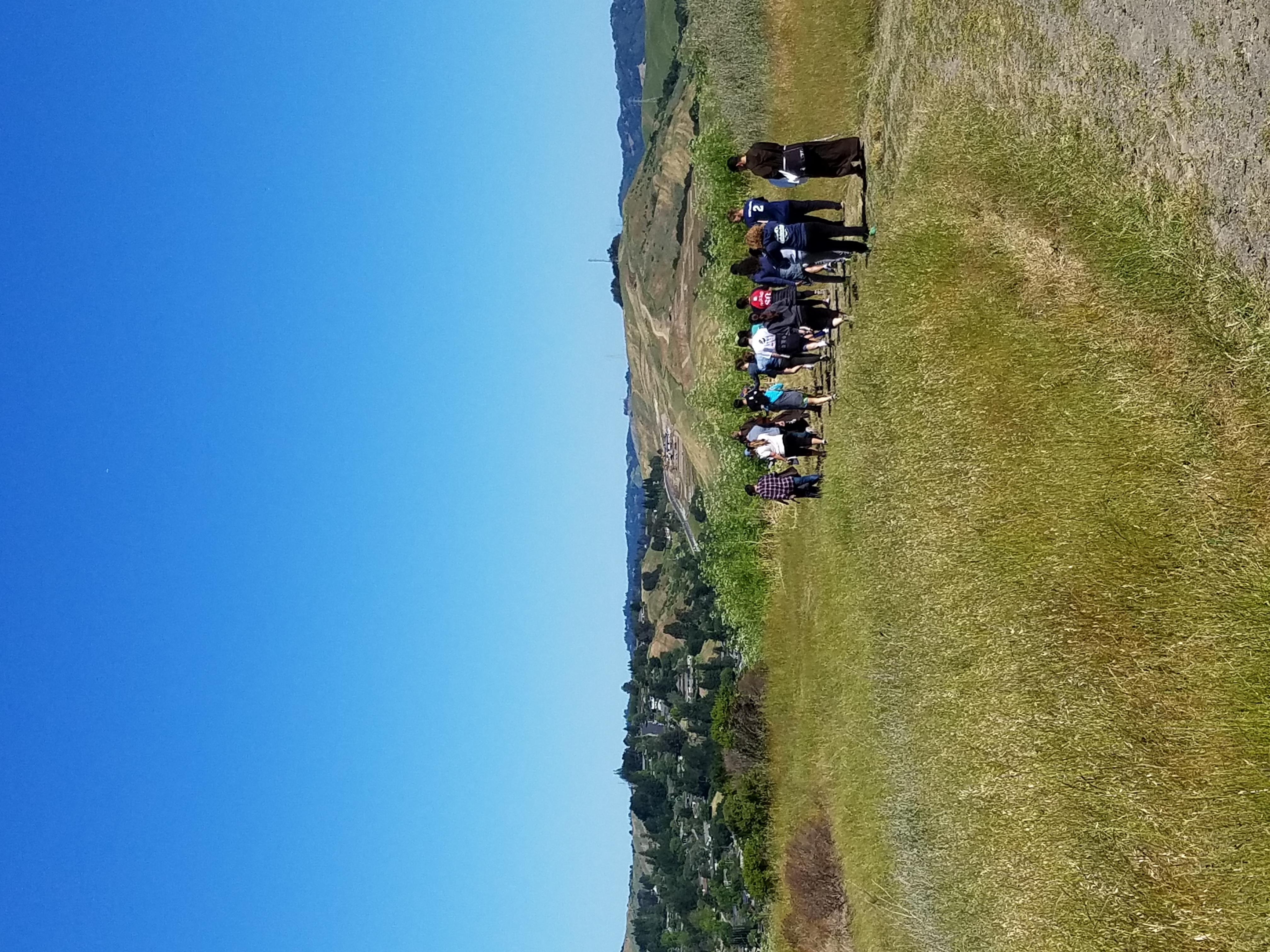 students hike through the hills of SMC and pray and worship together