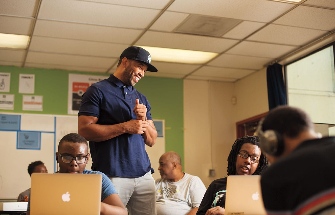 Sean Valentine '14 works with high school students at the Hidden Genius Project, an Oakland nonprofit that helps prepare young black men to enter the high-tech work world.