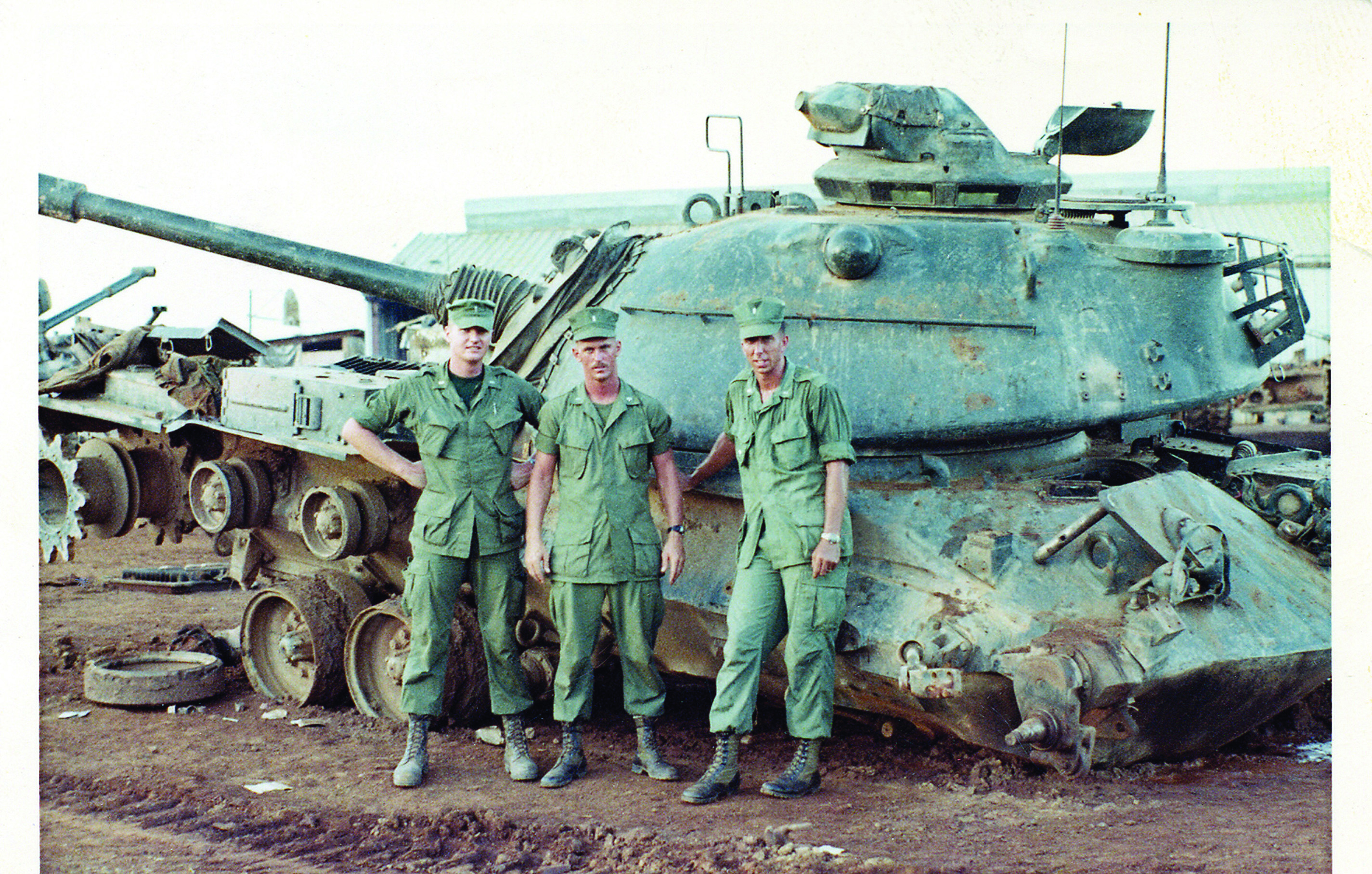 Russ Harrison MBA '79, right, with two other Marine Corps lieutenants in front of his tank after it had hit a land mine. Harrison, who was wounded twice in Vietnam, is the chair of SMC's Board of Trustees