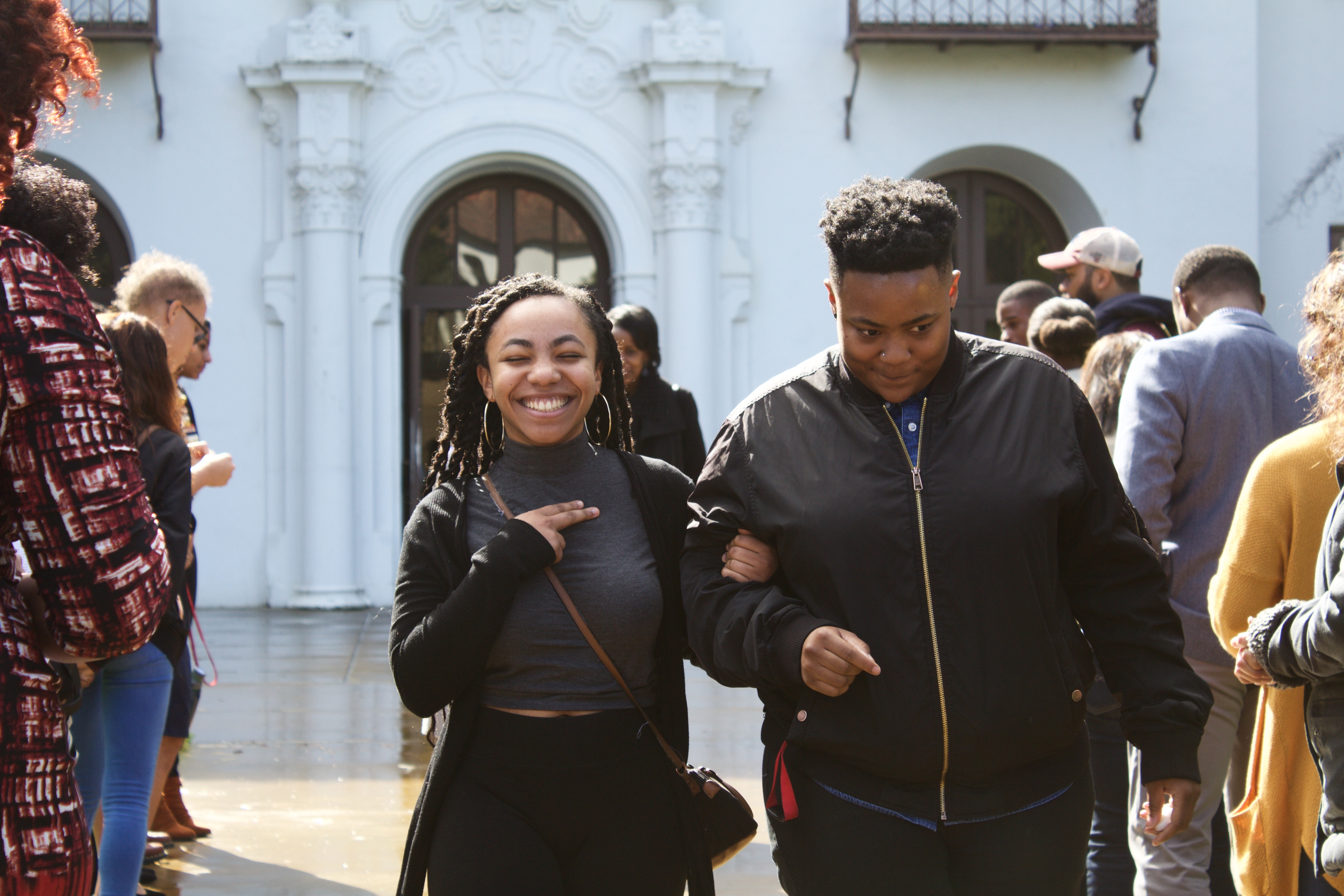 1 student and 1 alum walk hand in hand at Black Convovation