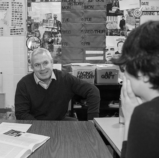 Robert Lenz '86 in classroom with student.