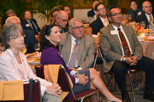 AICCU President Kristen Soares (in purple) and other attendees listened to Bonilla