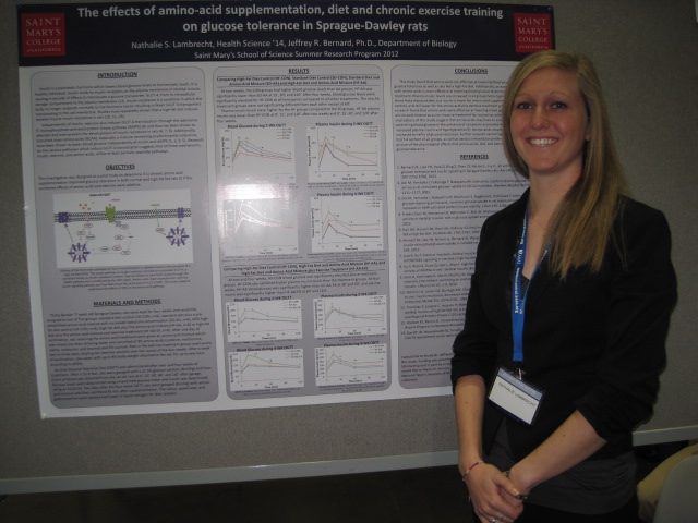 Nathalie Lambrecht with her poster at the AAAS meeting in Boston.