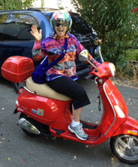 Susan Chritton showing off her 'freak factor' on her red Vespa