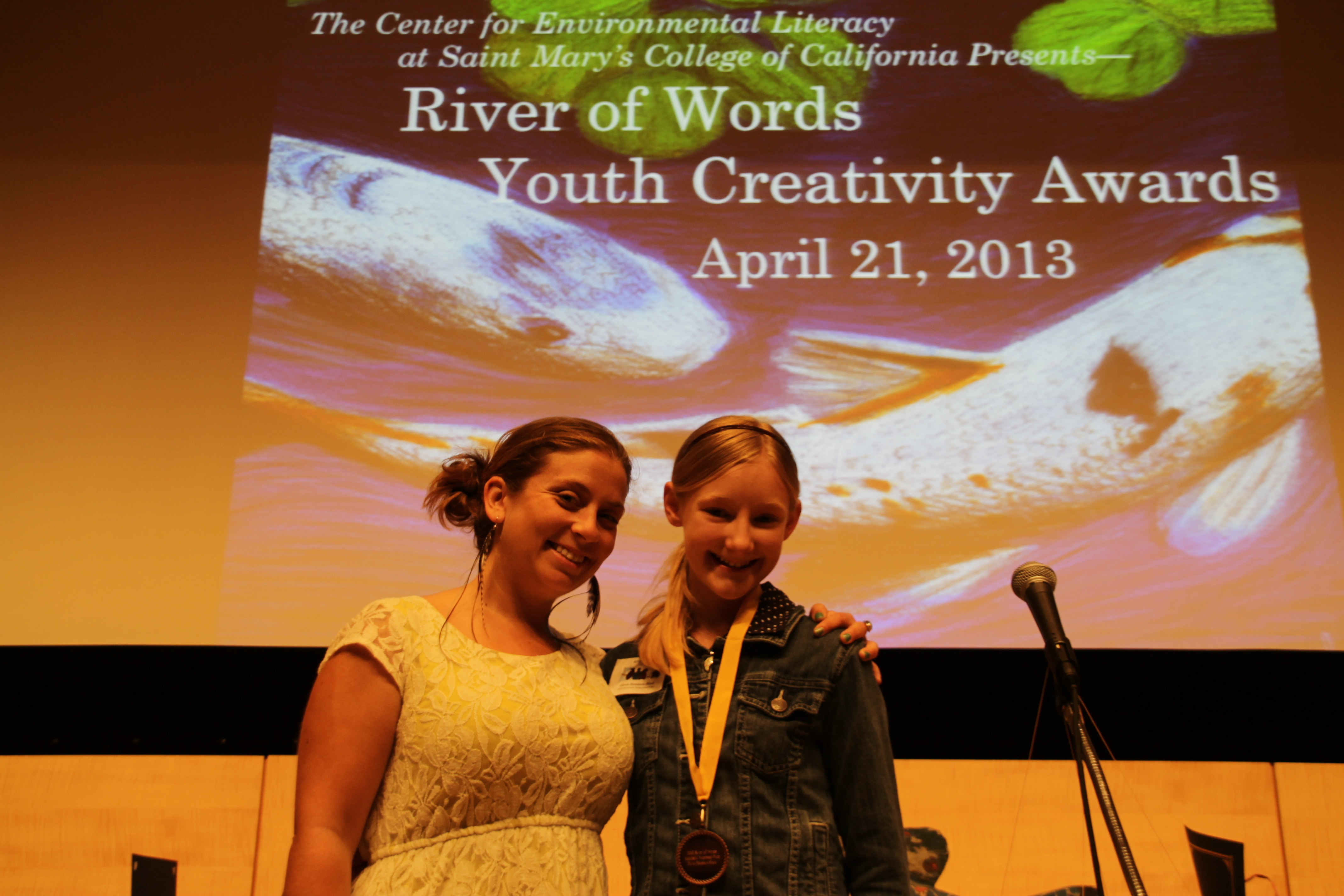 "2013 River of Words Anacostia Watershed Prizewinner, Olivia Henshaw-Black, with her former teacher, the ""Gypsy Gardener"""