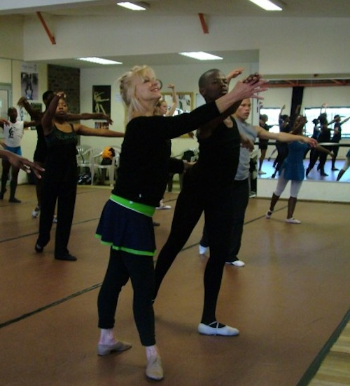 Kristine Elliott refines hands in arabesque in class at Dance For All.