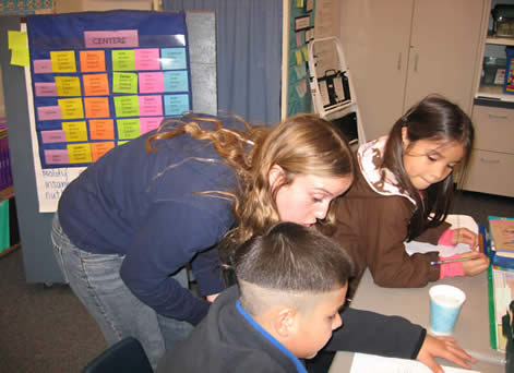 Third grade students reported at the beginning and end of the experiments.  College students listened and sometimes offered input especially during the setup of the experiment. (photo by CILSA staff)