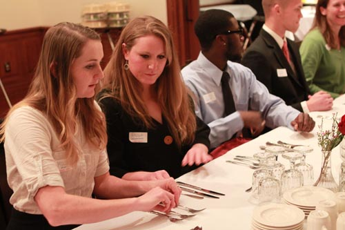 Students at a dinner last year try to figure out which fork to use.