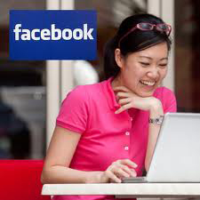 Woman with computer and Facebook logo