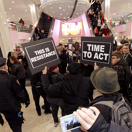 People protesting for fair trade at a mall.