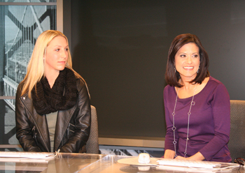 SMC Junior Melanie Smith (left) tries out the anchor's desk at the NBC Bay Area TV studio.