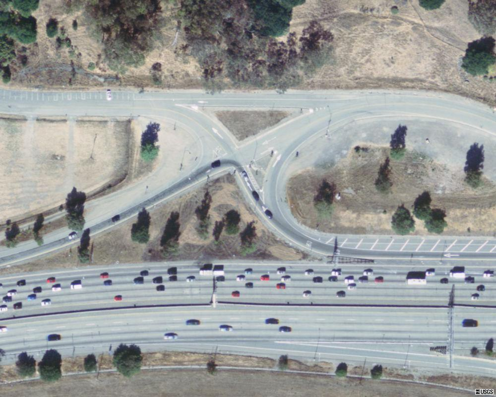 Highway 24 field site:  Shakespeare Way and Wilder Road interchange with on ramp and off ramp forming triangular shaped parcel for westward moving traffic.