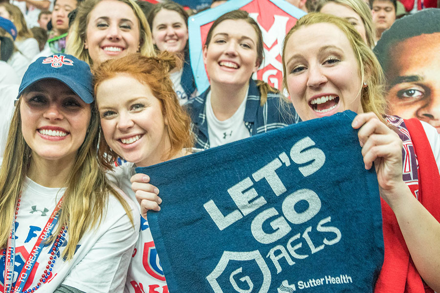 Students pose at the Gonzaga game on campus.