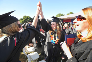 New grads celebrate with high five