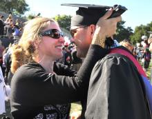 Grad gets a kiss from loved one