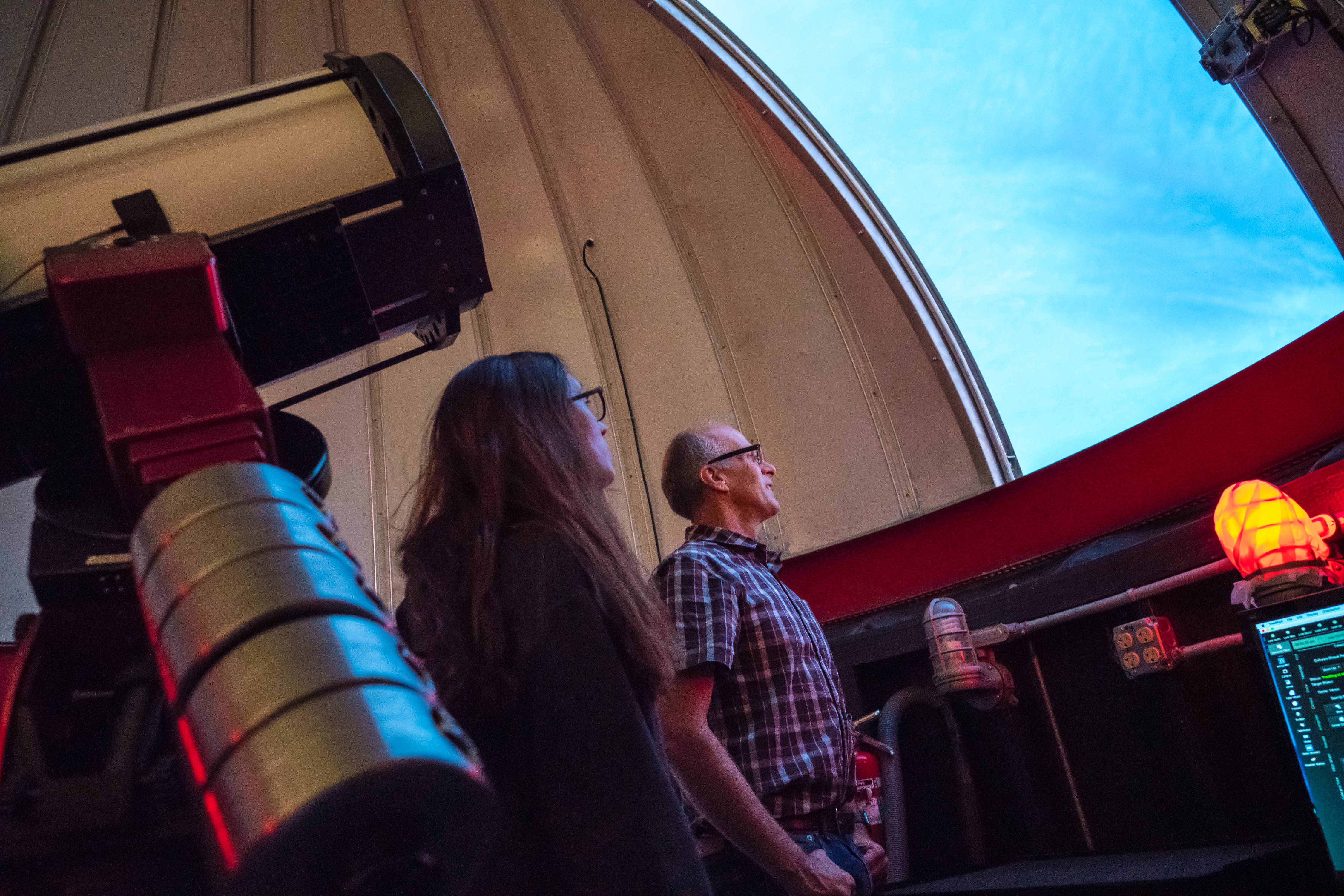 Brian Hill and former student Arriana Hoflemann at the Geissberger Observatory.