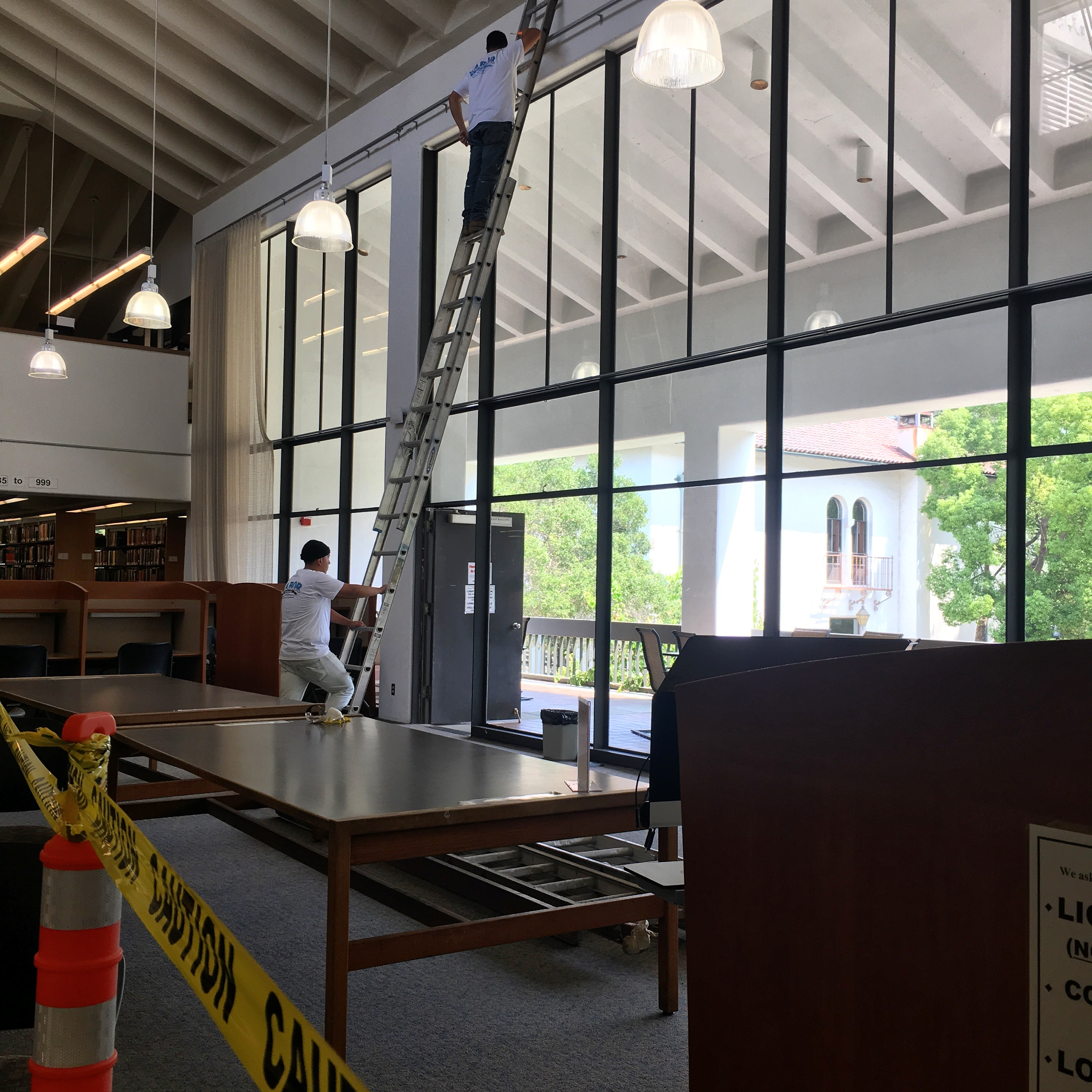 Taking down library curtains