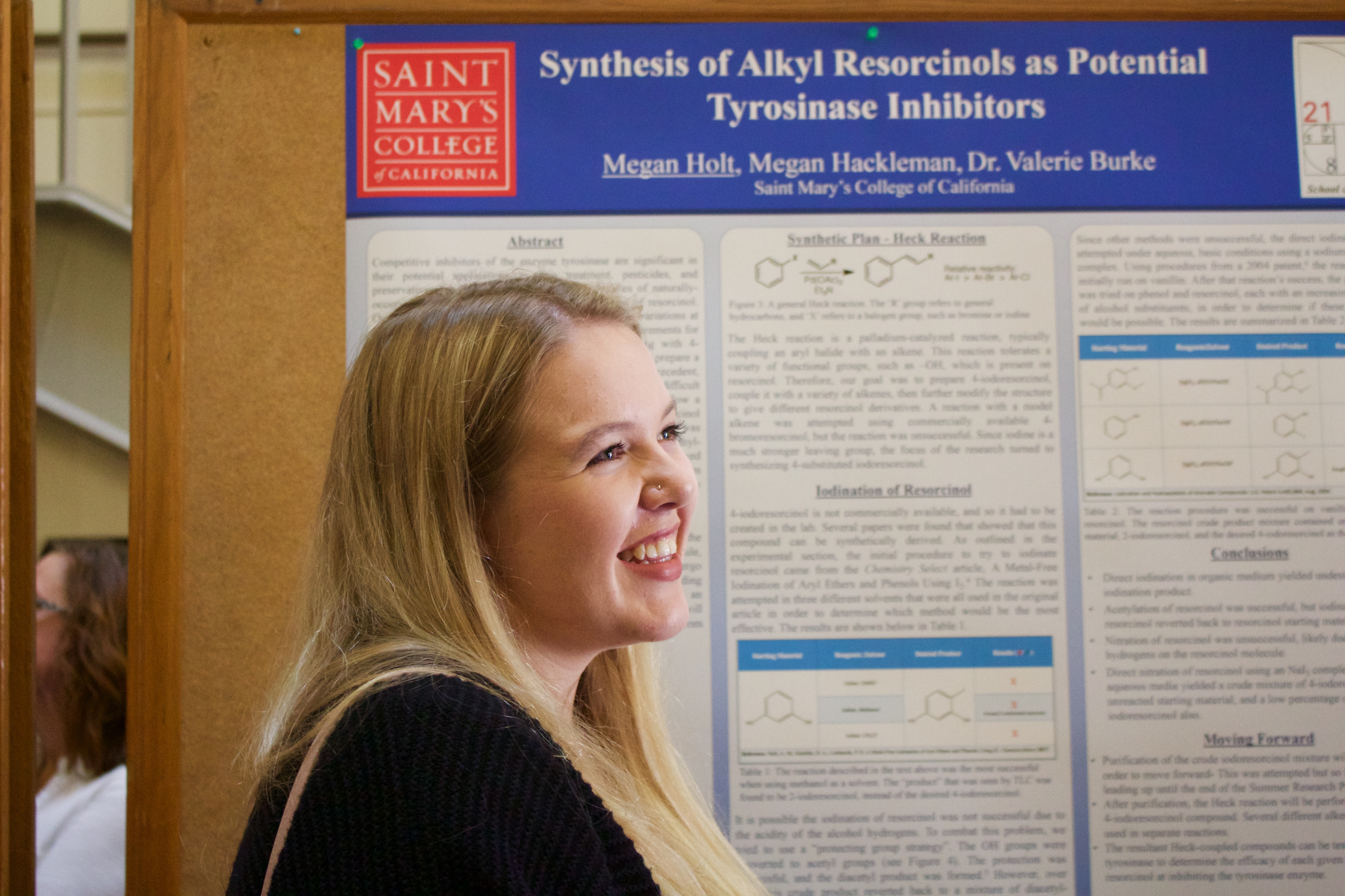 Student stands in front of her summer research project.