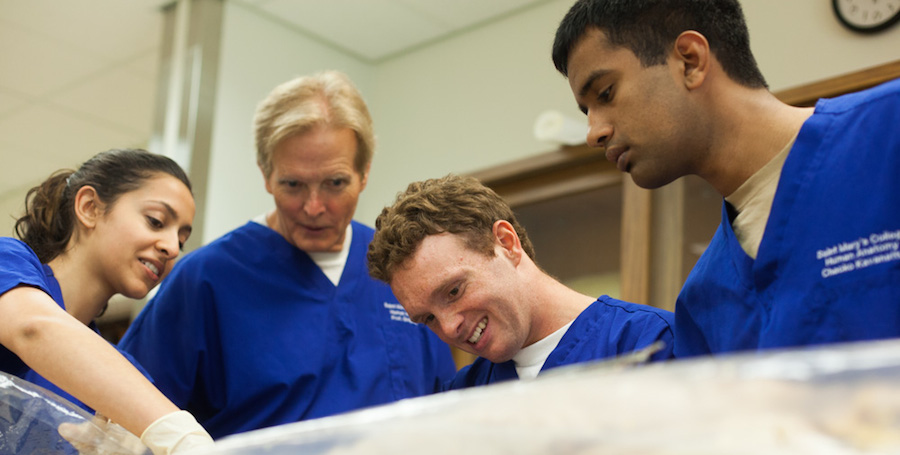 From left to right: Nikita Chaudri '15, Professor Greg Smith, Jonathan Zeitler '15, and Chacko Karanattu '16 marvel at the human body in Smith's Advanced Human Anatomy class.