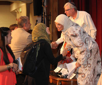 Ameena Jandali greeted an SMC Muslim graduate student, and Ken Maki (in the background) shook hands with Ed Tywoniak