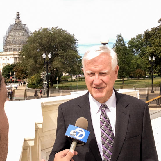 President Jim Donahue being interviewed outside Capitol Hill.