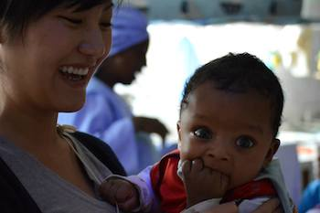 Karen Trang holds a baby during her Jan Term trip to Ethiopia.