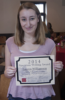 Lauren Williamson shows us her Spectrum Writing Award certificate.