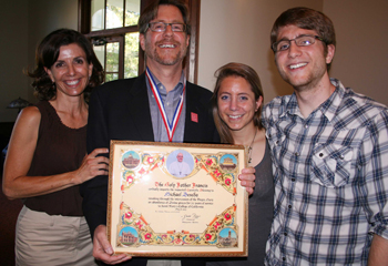 Michael Beseda with his family and a blessing from the pope.