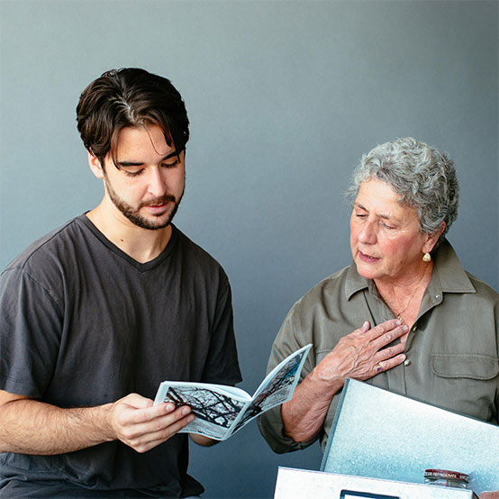 Janet Clark, a former IRS agent, has begun work on a mystery novel, an offshoot of her experience as one of 20 seniors taking Document Your Life Story at Lafayette Community Center, taught by creative writing graduate students at Saint Mary's. Here, Clark confers with M.F.A. student Michael Caligaris.