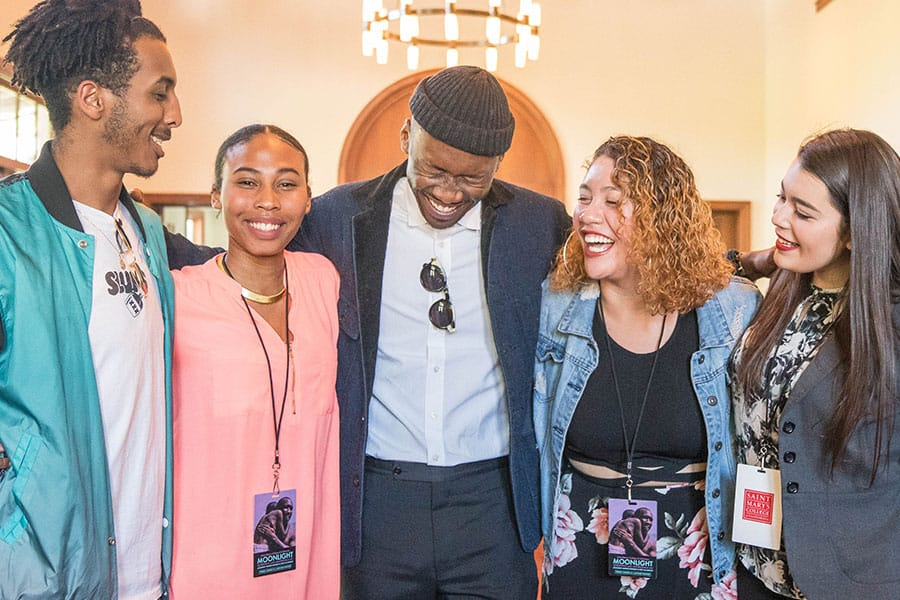 Mahershala Ali '96 laughs with students during an HP reception.