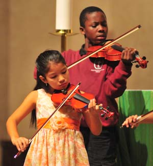 Young violinists from St. Martin de Porres Elementary School.