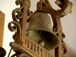 Saint Mary's most curious bell is the Mexican Monastery Gate Bell with its attendant friar and ornate wrought-iron mounting. The Gate Bell was once mounted on the Rheem Estate Stables before it was subdivided for development in the 1950s. The bell now watches over library activities from a pillar next to the library circulation desk.