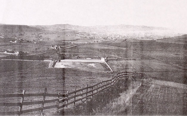 The original Saint Mary's campus, shown in this 1875 photo, was a windswept place with its own livestock pen on the outskirts of San Francisco, far from the temptations of the Barbary Coast.
