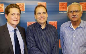 Brandon Pierce (left) with Ted Kummert, former data chief of Microsoft (center), and Communication Professor Fr. Michael Russo