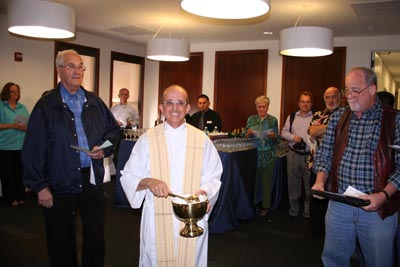 Father Salvatore Ragusa blessed the new space at the grand opening reception.