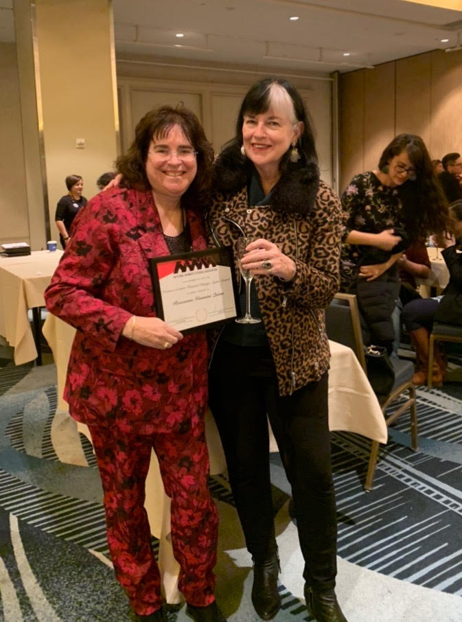 Celebrating Roseanne Quinn's NWSA award as Feminist Change Agent, with Professor Denise Witzig, WaGS. Hilton Hotel, S.F., 11-16-19.