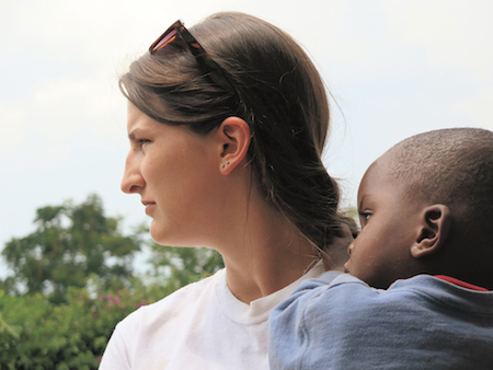 Meg Mulvaney, shown with a Rwandan boy named Cedric, is now a graduate student in the Teachers for Tomorrow program. After graduating in May, she plans to pursue service-related opportunities before she begins teaching.