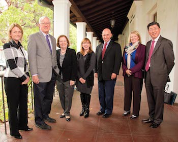 Provost Bethami Dobkin, President James Donahue, four members of the AACSB accrediting team and, on the right, SEBA Dean Zhan Li.