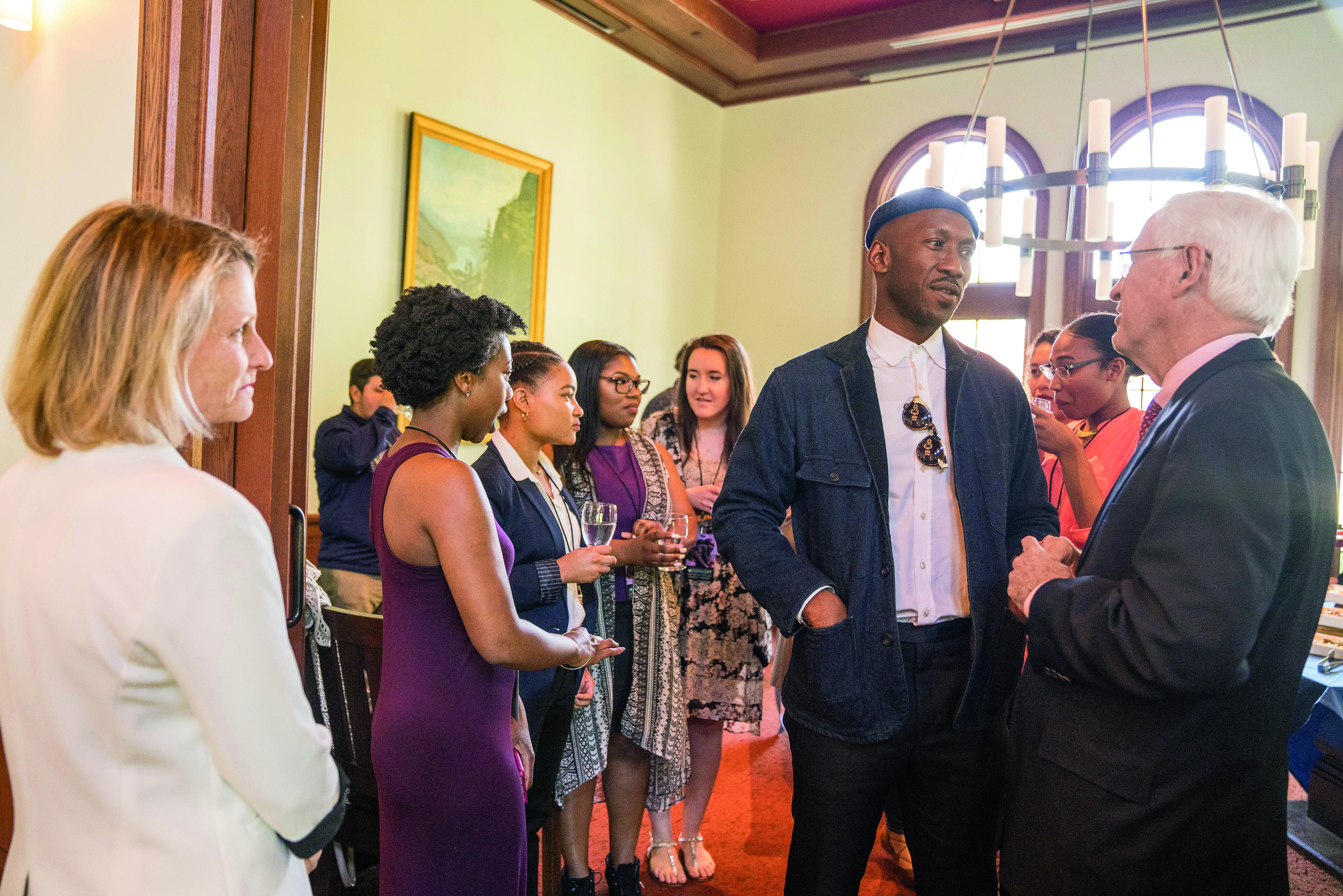 Mahershala Ali '96 with President James Donahue and with students at a reception for the HP program.