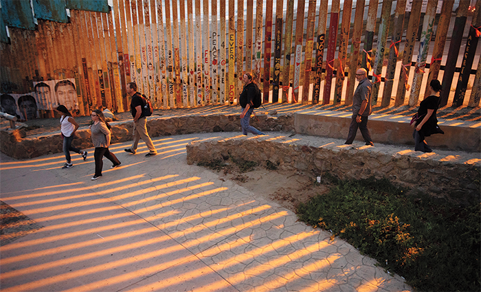 Faculty looking through the border wall