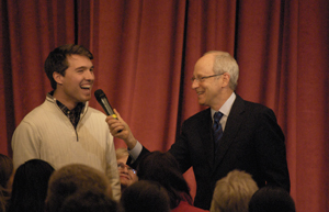 Michael Sandel engages with SMC student Will Hawley during the community forum.