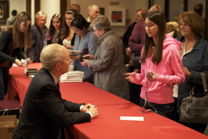 Sandel signed copies of his latest book and spoke with students after the presentation.