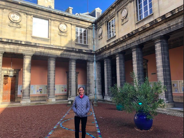 Associate Professor Helga Lenart-Cheng in the courtyard of the University of Bordeaux, France.
