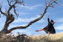 Photo of Shaunna Vella dancing outside near tree