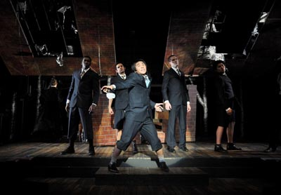 "Oliver Reyes (center) and other cast members in ""Spring Awakening"""