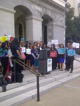 During a news conference on the steps of the Capitol, Jessi Bailey '15 argues for proposed legislation to guarantee adequate funding for Cal Grants.