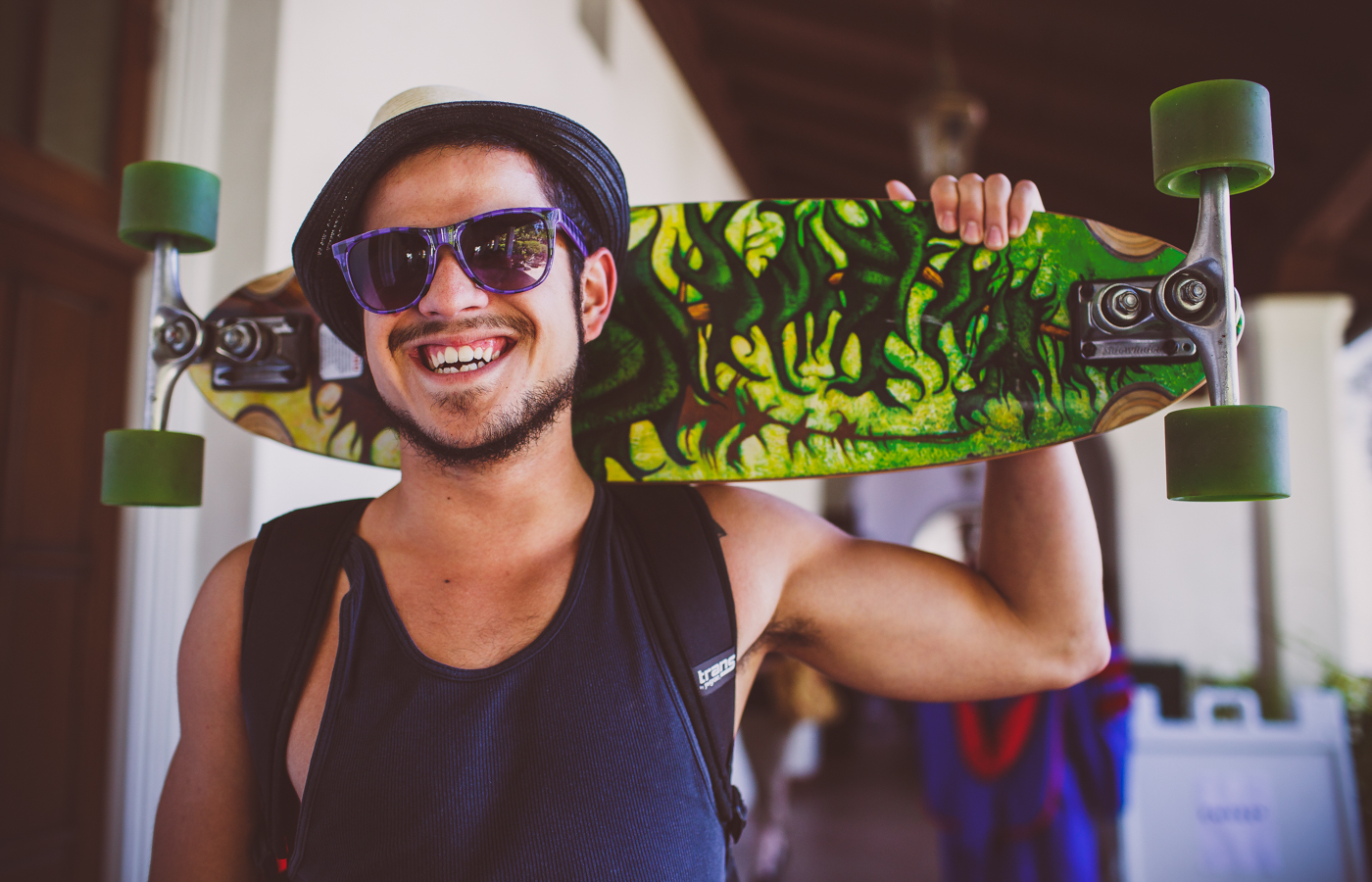 Male student with skateboard.
