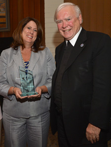 Brother Ronald  and Assemblymember Susan Bonilla, with her award